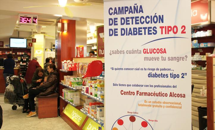 Cartel de la campaña situado en el interior de la farmacia Alcosa