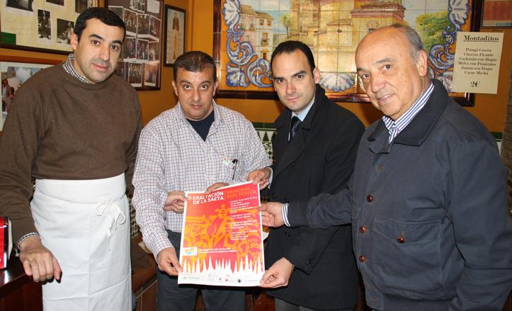 Álvaro Peregil, José Manuel Mira, Rafael Belmonte y Miguel Ángel Pérez junto al cartel de la exaltación