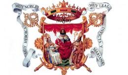 Escudo de Sevilla, donde se aprecian sus diversos títulos