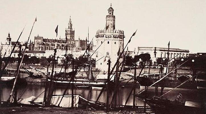 La torre del Oro con sus barcos en el Guadalquivir