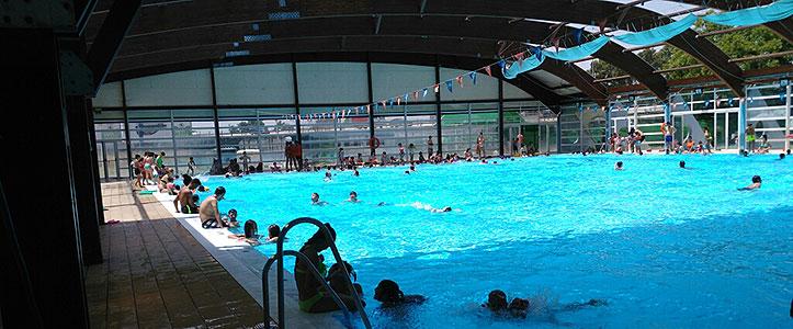Las piscinas municipales oasis urbanos en mitad de la for Piscinas imd sevilla